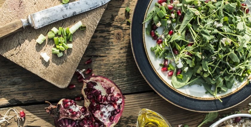 56370906 - green salad with pomegranate, manna croup, onion. pomegranate dressing.