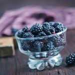 43378067 - black berries in bowl on a table