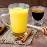 64117870 - turmeric golden milk latte with cinnamon sticks and honey. detox liver fat burner, immune boosting, anti inflammatory healthy cozy drink